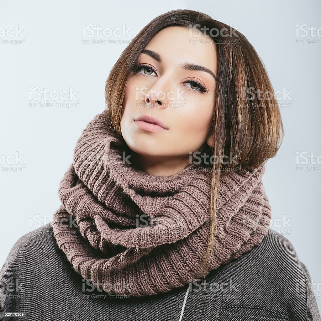 Fashionable girl in winter knitted clothes stock photo