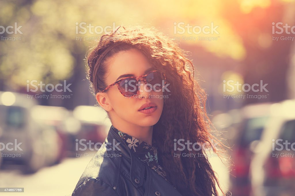 Fashionable girl on the street stock photo