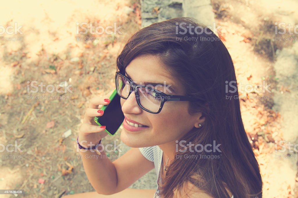 Fashionable girl using a cellphone. royalty-free stock photo