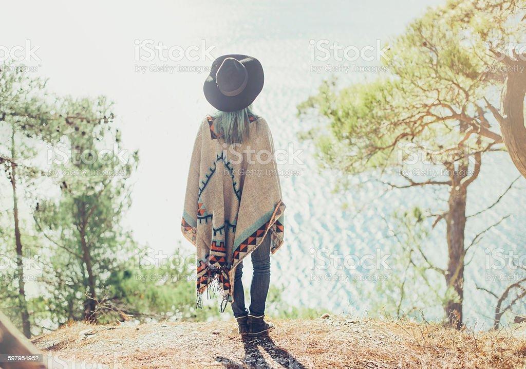 Fashionable girl walking on coast stock photo