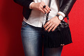 Fashionable girl with accessories handbag watch