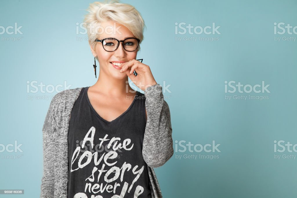 Fashionable Girl With Glasses And Short Hair And Dressed In