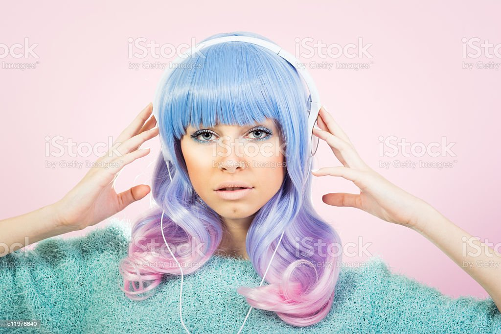 Fashionable girl with pastel hair and headphones stock photo