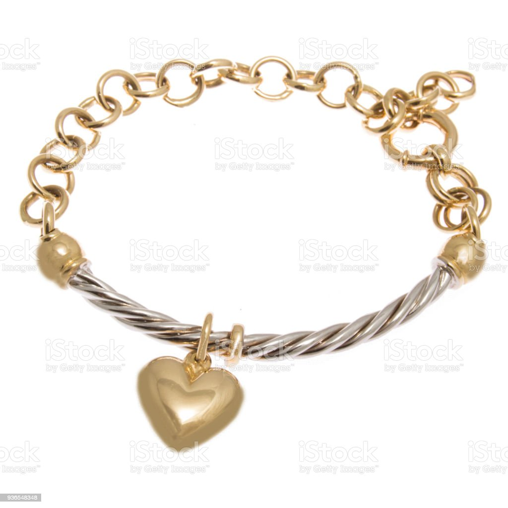 Fashionable golden bracelet with heart shape pendant from yellow and white gold stock photo