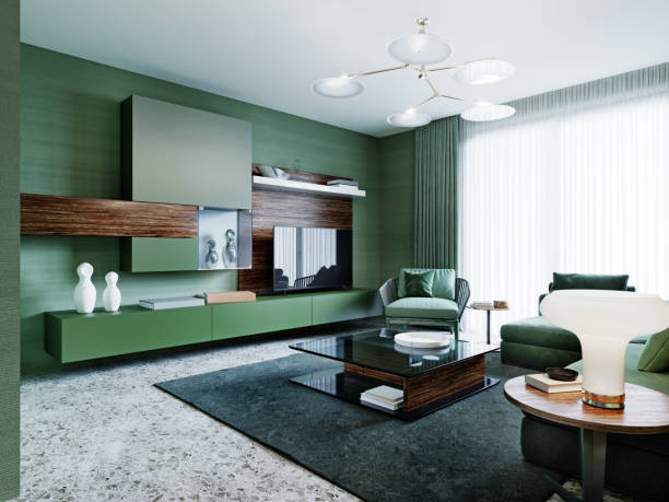 Fashionable green color living room with corner sofa and wood paneling on the walls and with a round mirror with light.