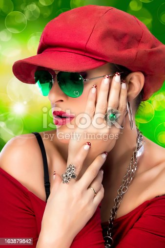 807419930istockphoto Fashionable Hip Hop Woman. Beauty Party Girl 163879842