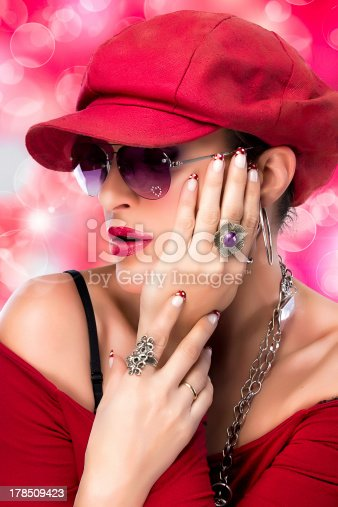 807419930istockphoto Fashionable Hiphop Girl. Beauty Brunette with Red Cap. 178509423