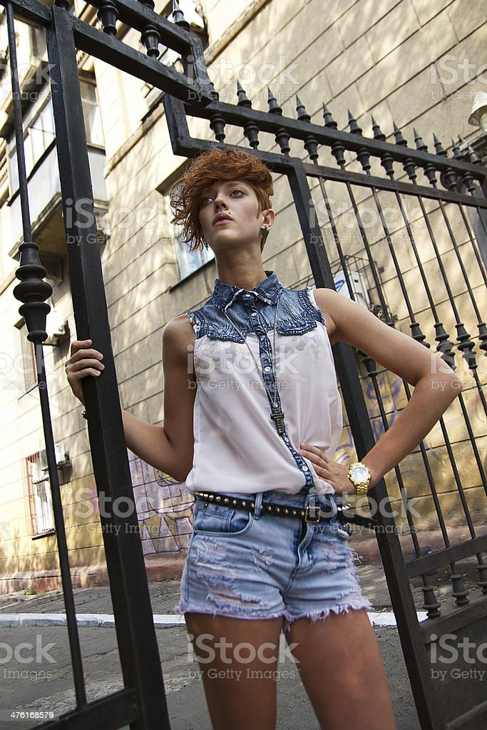 Fashionable hipster girl posing stock photo