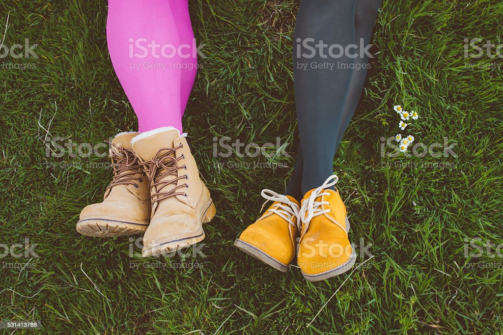 Fashionable ladies' shoes on grass with Daisy detail stock photo