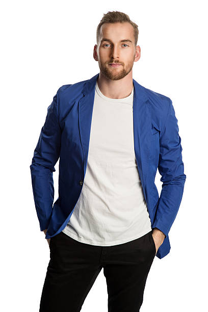 Fashionable male in blue jacket staring stock photo