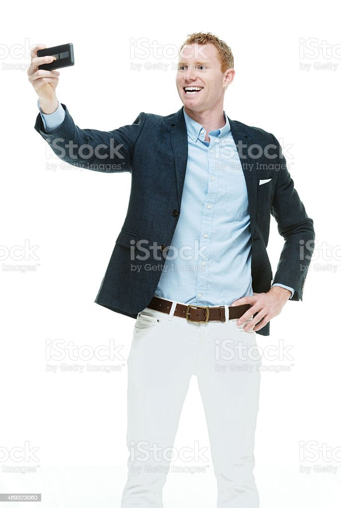Fashionable male taking a selfie stock photo