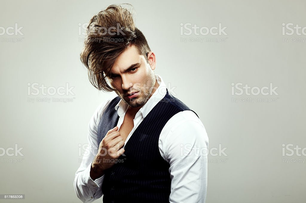 Fashionable man posing in the studio stock photo