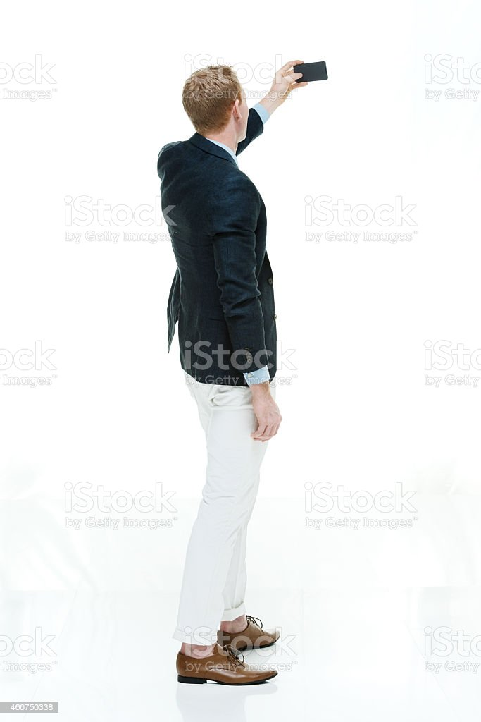 Fashionable man taking a selfie stock photo