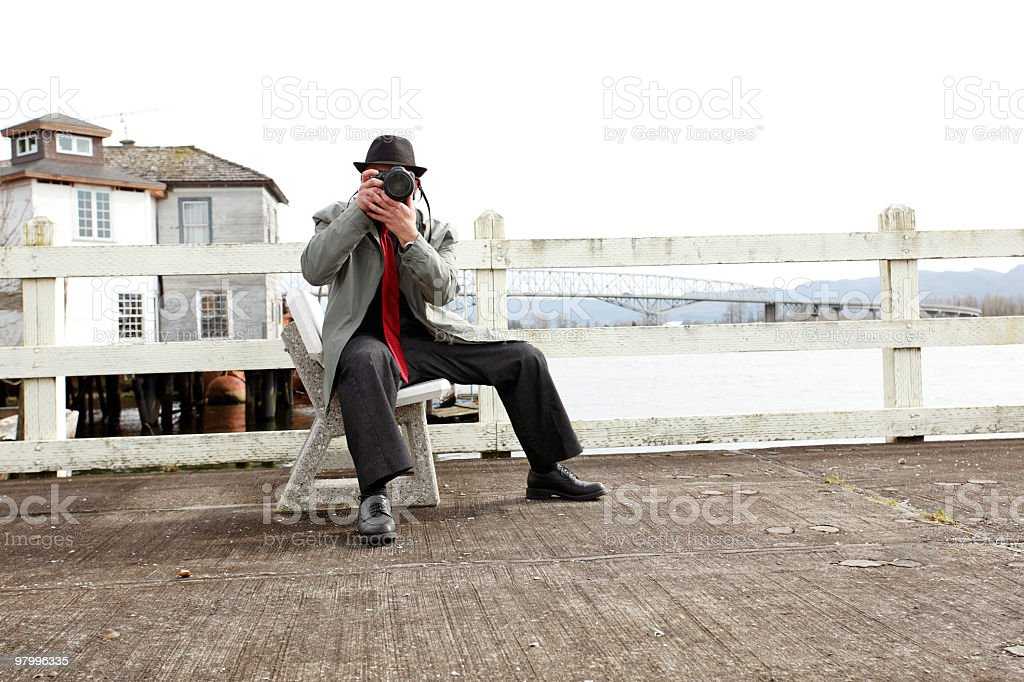 Fashionable man taking pictures royalty free stockfoto
