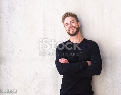istock Fashionable man with beard laughing 506131362
