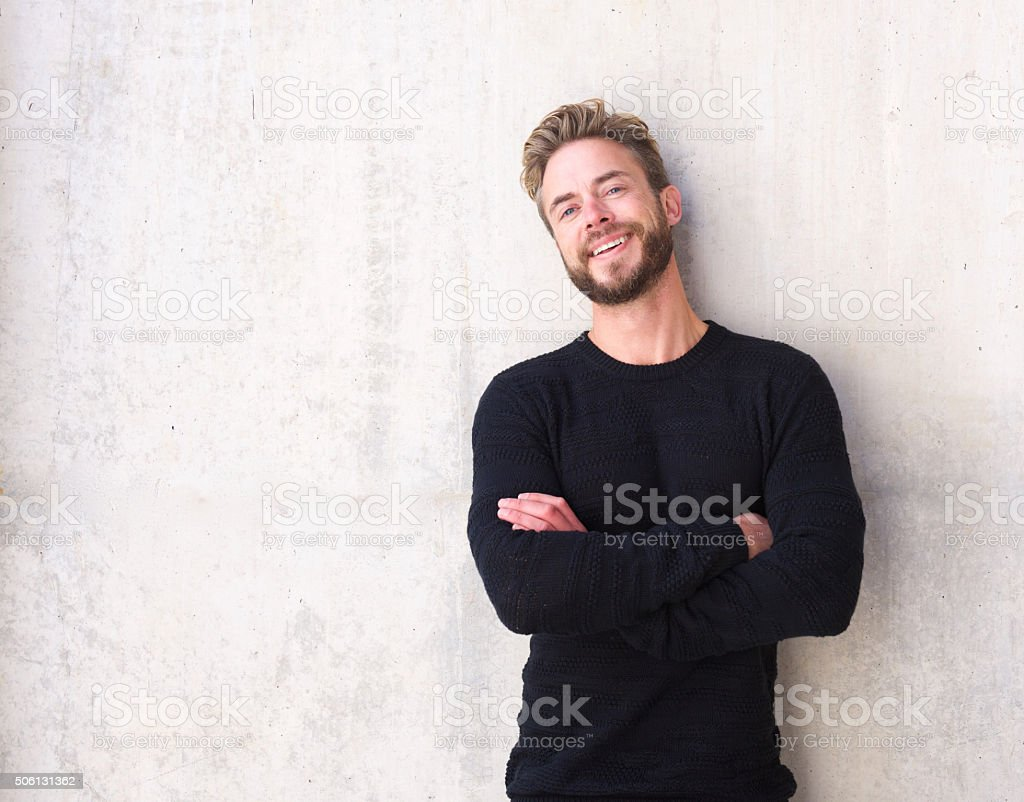 Fashionable man with beard laughing stock photo