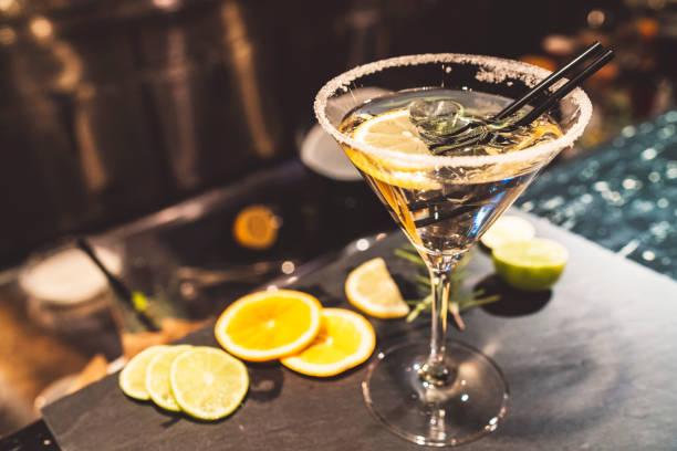 Fashionable martini with garnishes stock photo
