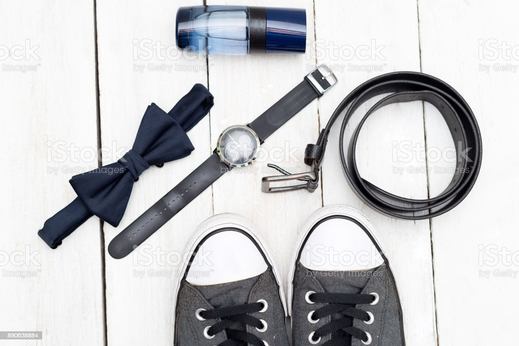 Fashionable men's accessories and shoes on a wooden background. Flat lay stock photo