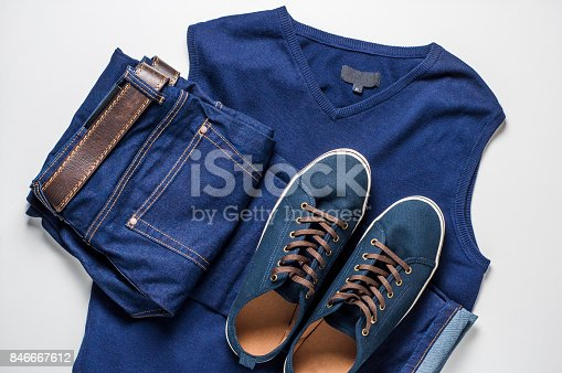 917262406istockphoto Fashionable men's clothing. Jeans and shoes on light background 846667612