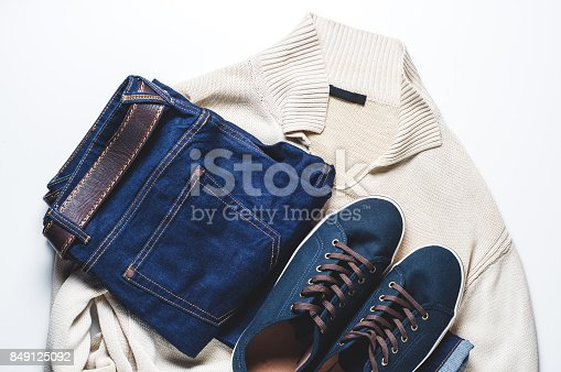 917262406istockphoto Fashionable men's clothing. Jeans and shoes on light background 849125092