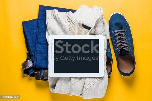 917262406istockphoto Fashionable men's clothing. Jeans and shoes on yellow background 846667602