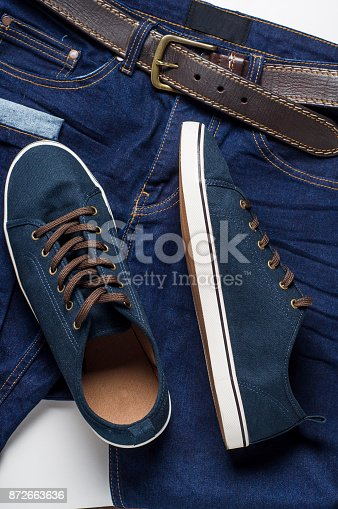 917262406istockphoto Fashionable men's clothing. Jeans and shoes. 872663636