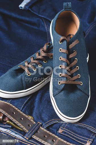 917262406istockphoto Fashionable men's clothing. Jeans and shoes. Vertical frame 859996174
