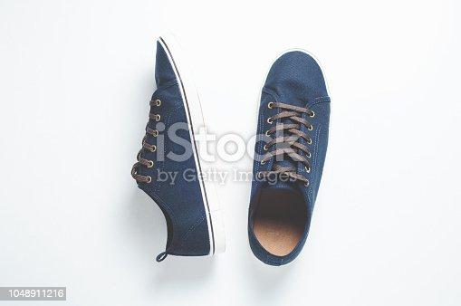917262406istockphoto Fashionable men's shoes isilated on white background 1048911216