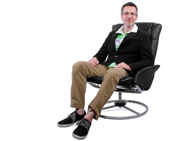 Fashionable Middle Aged Man With Shoes and No Socks stock photo