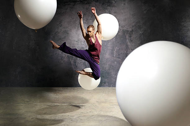 Fashionable modern dance Young energetic dancer performs modern dance pose male animal stock pictures, royalty-free photos & images