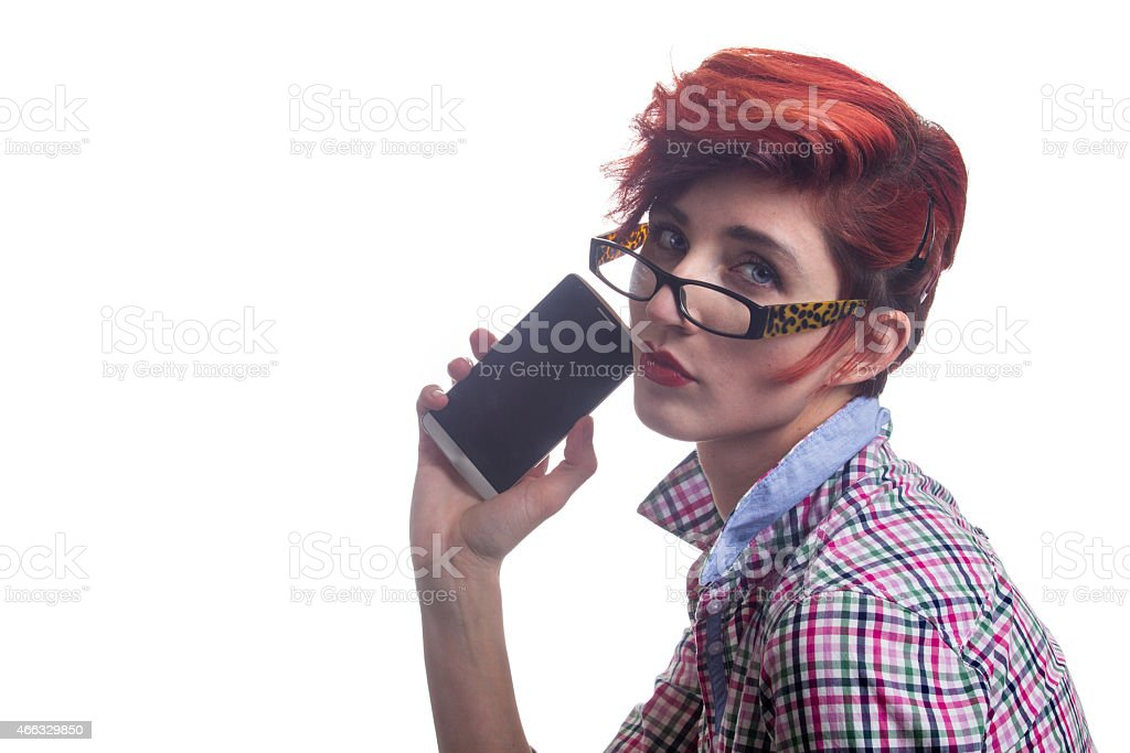 Fashionable modern red haired business woman holds smartphone stock photo