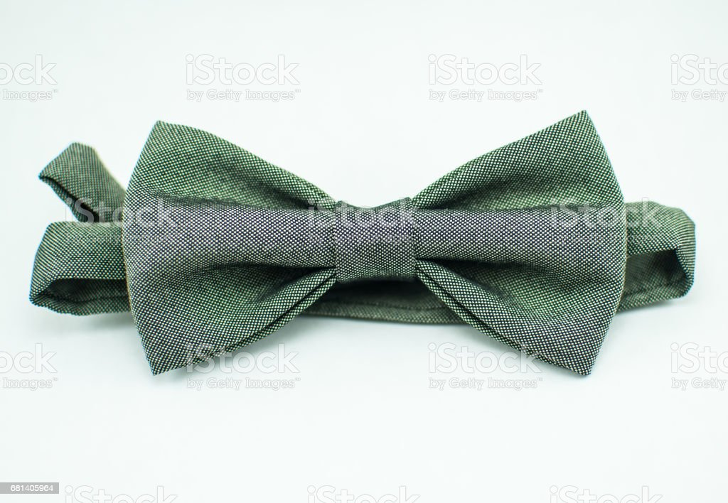 Fashionable pale-green bow tie on a white background; isolated; closeup royalty-free stock photo