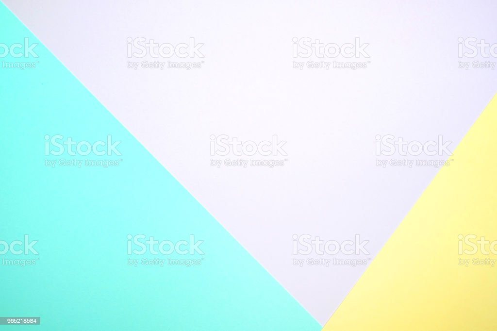 Fashionable  pastel colored paper flat lay top view, geometric background texture, pink, purple, yellow, beige, green and blue. royalty-free stock photo