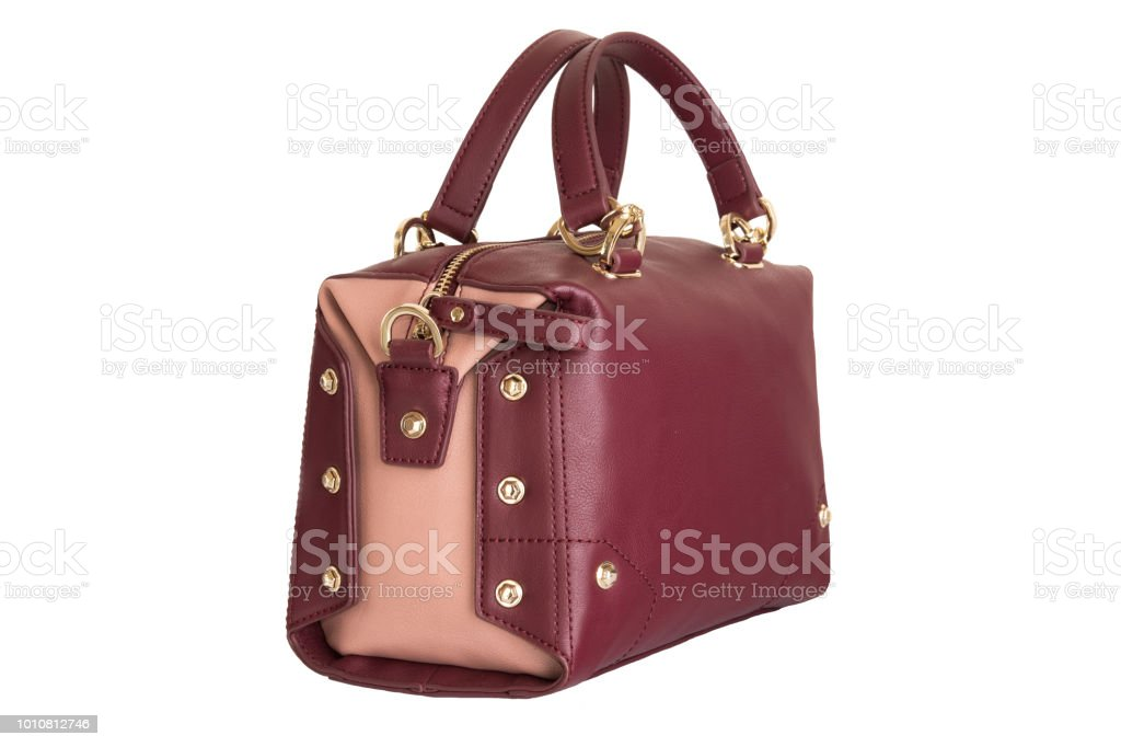 dff887e5b2c6e Fashionable red burgundy female women bag isolated on white background. -  Stock image .