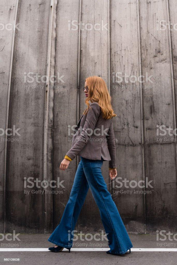 fashionable redhead girl stock photo