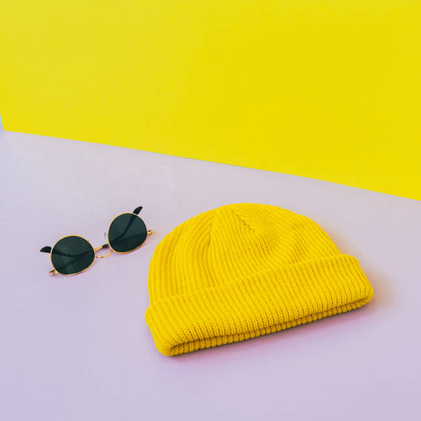 Fashionable set with yellow beanie hat and sunglasses