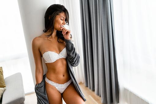 Fashionable sexy woman wearing white lingerie, amazing body. Fashion, woman, beauty concept