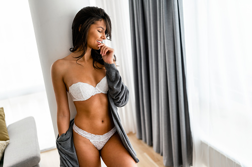 Fashionable sexy woman wearing white lingerie, amazing body.