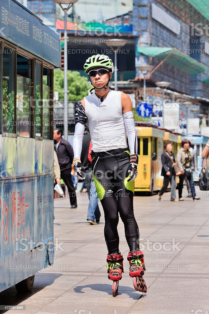 Fashionable skater rides in Nanjing East Road, Shanghai, China stock photo