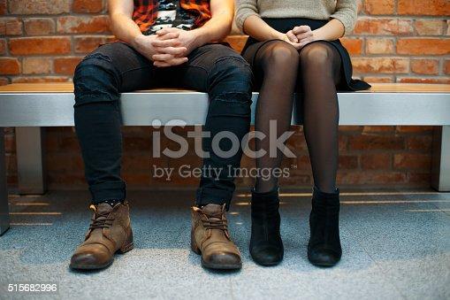 istock Fashionable stylish couple sitting on the bench. Legs close-up 515682996