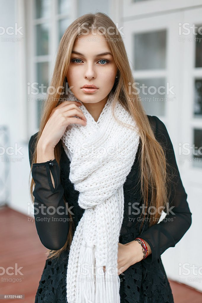 Fashionable stylish girl with a white warm scarf stock photo