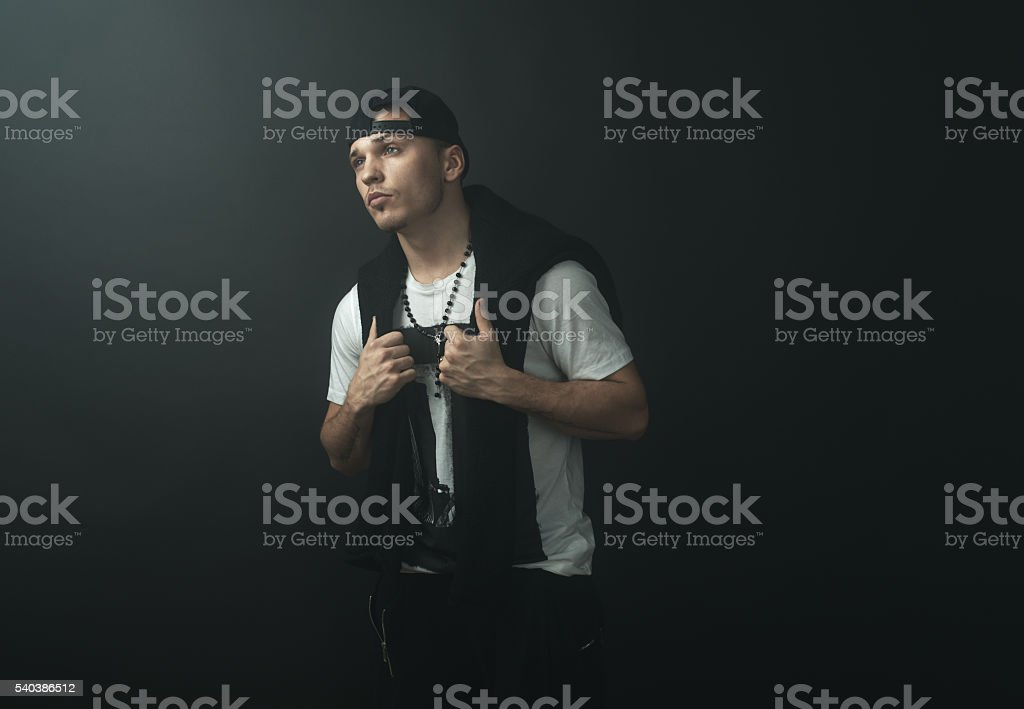 Fashionable stylish man in  darkness stock photo