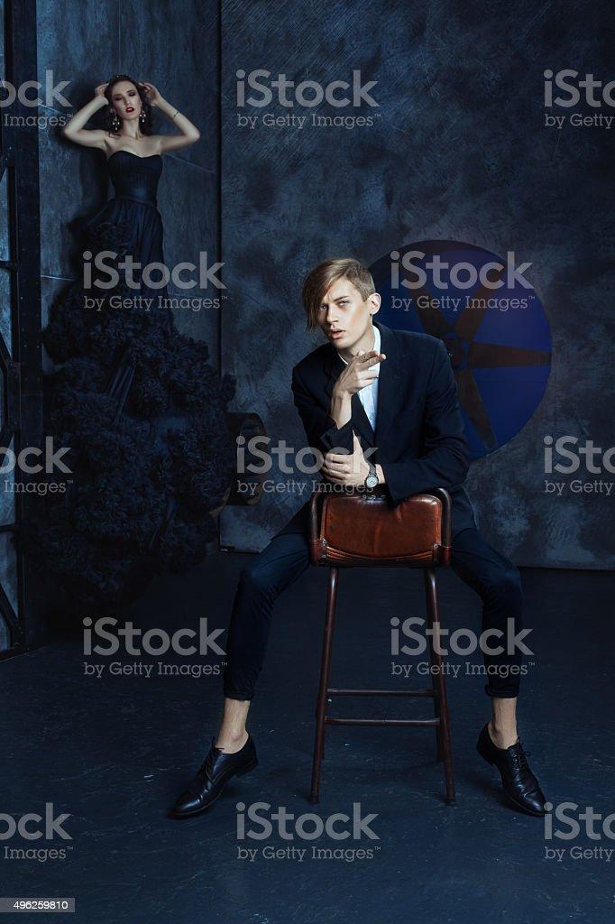 Fashionable stylish man sitting on a chair. stock photo
