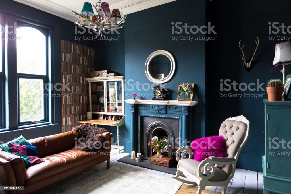 Fashionable vintage styled living room Living room with high ceilings and architectural featuresLiving room with high ceilings and architectural features Antique Stock Photo