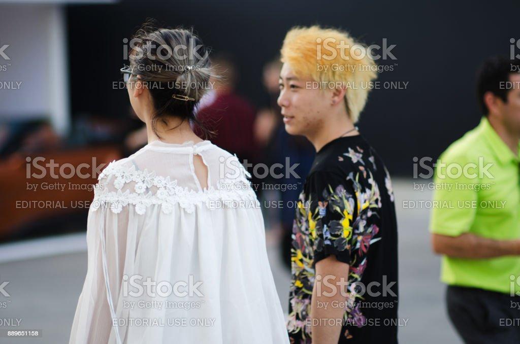 Fashionable Visitors Outside Art Basel Miami Beach stock photo