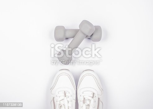 Fashionable White Sport Sneacker with Dumbbell Isolated on White