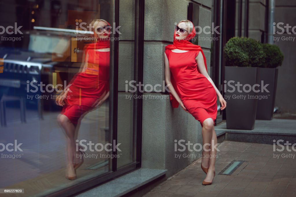 Fashionable woman admires herself. stock photo