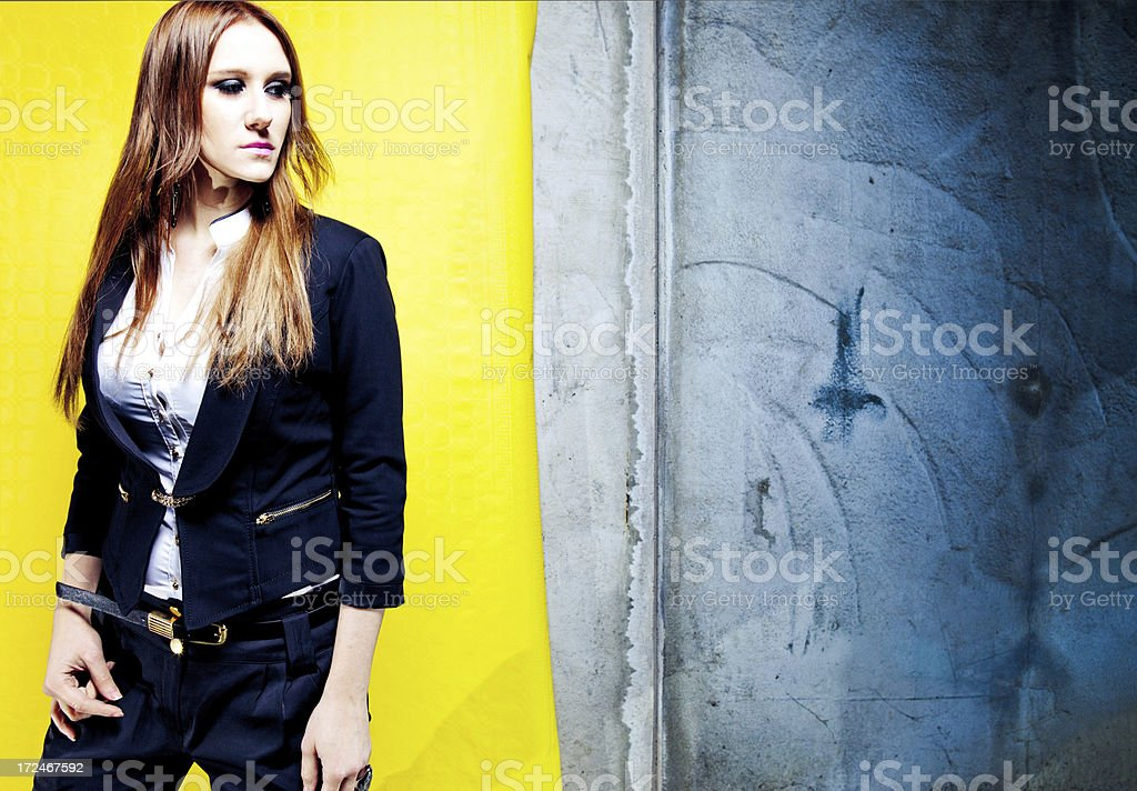Fashionable woman against grungy background royalty-free stock photo