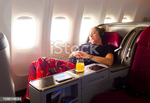fashionable woman flying in business class, airplane