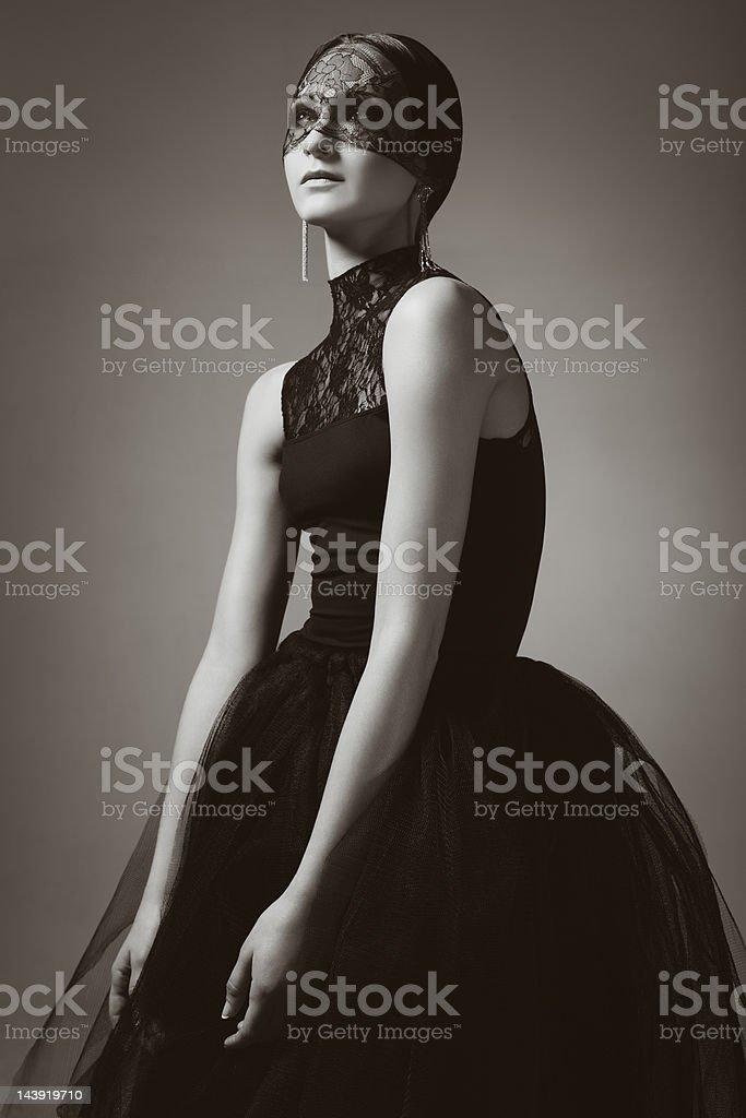 Fashionable woman in elegant black dress royalty-free stock photo